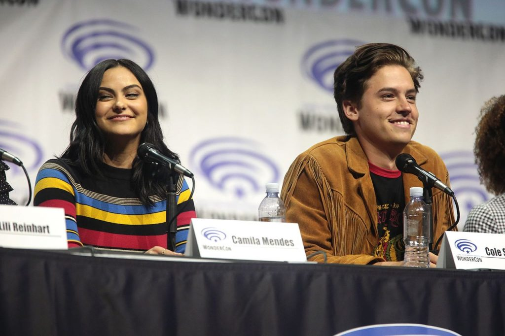 Camila Mendes and Cole Sprouse speaking at the 2017 WonderCon